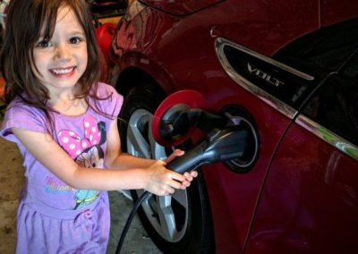 Raising her right! Ohio girl plugging ClipperCreek into her family's Volt