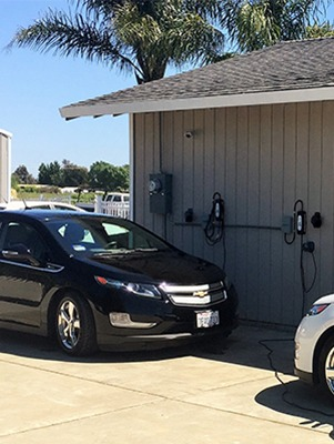 Two Chevy Volts charging with LCS-20, 16-Amp charging stations