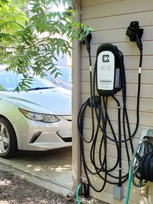 Residental HCS-D40 with two Chevy Volt EVs with green leafy tree